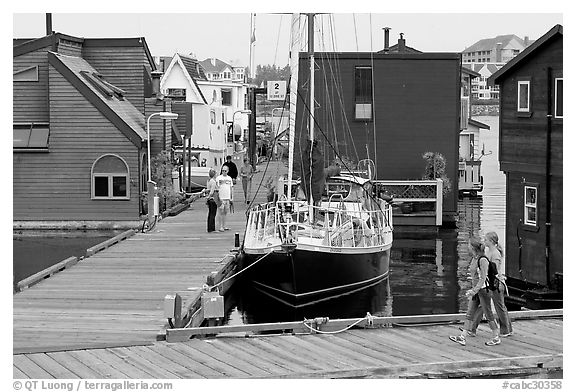 Houseboats, deck, and sailboat, Upper Harbour. Victoria, British Columbia, Canada (black and white)