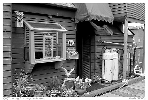 Houseboat window and propane tanks. Victoria, British Columbia, Canada (black and white)