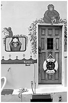 Door of houseboat decorated with a monkey theme. Victoria, British Columbia, Canada (black and white)