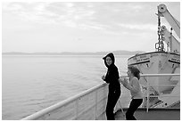 Woman and girl looking out from deck of ferry. Vancouver Island, British Columbia, Canada (black and white)