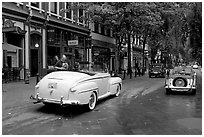 Classic cars in Water Street. Vancouver, British Columbia, Canada ( black and white)