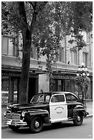 Old Police car in Water Street. Vancouver, British Columbia, Canada ( black and white)