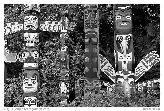Totem collection near the Capilano bridge. Vancouver, British Columbia, Canada (black and white)