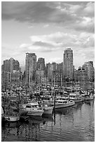 Skyline and boats seen from Fishermans harbor, late afternoon. Vancouver, British Columbia, Canada ( black and white)