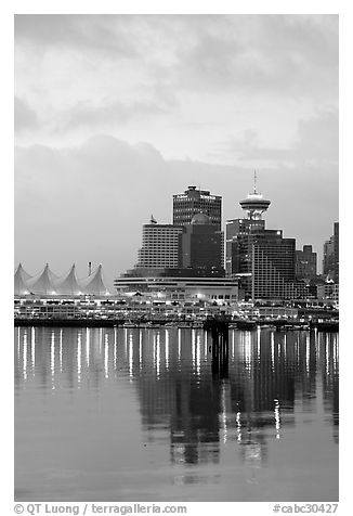 Canada Palace at night and Harbor Center at dawn. Vancouver, British Columbia, Canada (black and white)