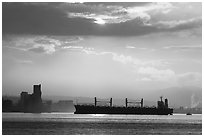 Cargo ship in harbor a sunrise. Vancouver, British Columbia, Canada (black and white)