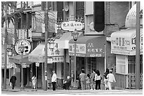 Street in Chinatown with red lamp posts and Chinese characters. Vancouver, British Columbia, Canada (black and white)