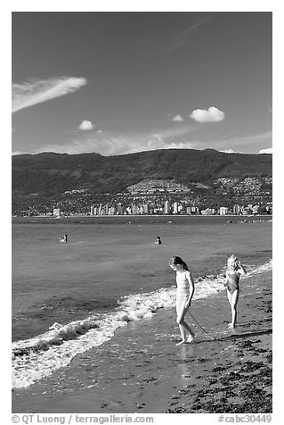Girls on a beach, Stanley Park. Vancouver, British Columbia, Canada (black and white)