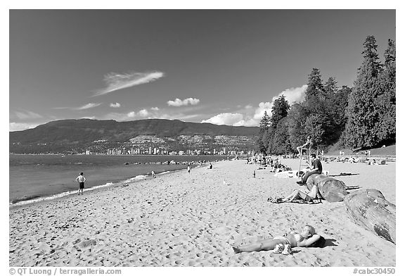 Woman sunning herself on a beach, Stanley Park. Vancouver, British Columbia, Canada (black and white)