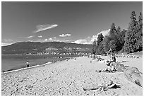 Woman sunning herself on a beach, Stanley Park. Vancouver, British Columbia, Canada ( black and white)