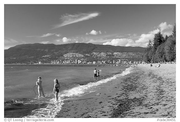 Girls playing in water, Stanley Park. Vancouver, British Columbia, Canada (black and white)
