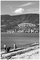 Family near the water on a beach, Stanley Park. Vancouver, British Columbia, Canada ( black and white)