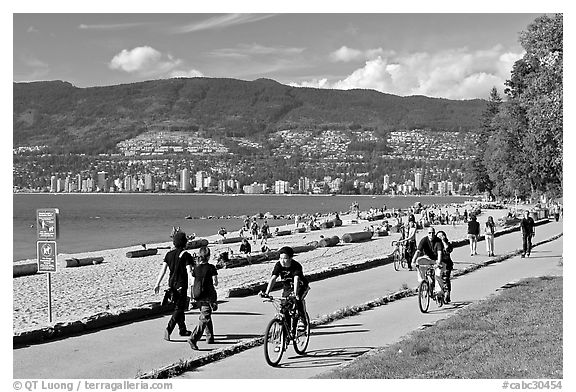 Bicyclists, and walkers,  Stanley Park. Vancouver, British Columbia, Canada (black and white)