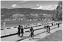 Bicyclists, and walkers,  Stanley Park. Vancouver, British Columbia, Canada ( black and white)