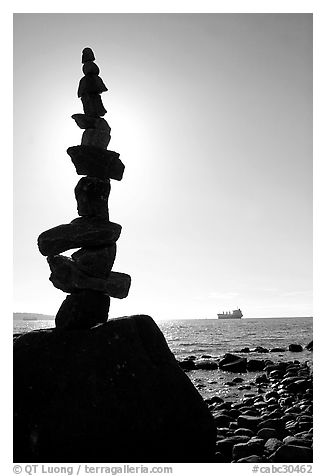 Backlit balanced rocks and ship in the distance. Vancouver, British Columbia, Canada (black and white)