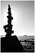 Backlit balanced rocks and ship in the distance. Vancouver, British Columbia, Canada ( black and white)