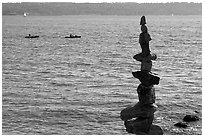Balanced rocks and kayaks in a distance. Vancouver, British Columbia, Canada ( black and white)
