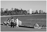 Family walking around Stanley Park. Vancouver, British Columbia, Canada ( black and white)