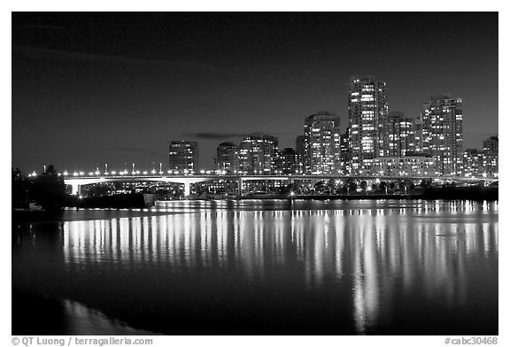 Black and white picture photo skyline seen across false creek at night vancouver british columbia canada