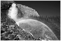 Rainbow at the base of Takakkaw Falls, late afternoon. Yoho National Park, Canadian Rockies, British Columbia, Canada (black and white)