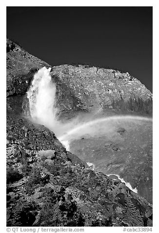 Rainbow formed in the mist of Takakkaw Falls. Yoho National Park, Canadian Rockies, British Columbia, Canada (black and white)