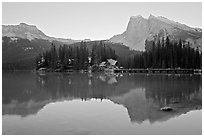 Cabins on the shore of Emerald Lake, with reflected mountains, sunset. Yoho National Park, Canadian Rockies, British Columbia, Canada (black and white)
