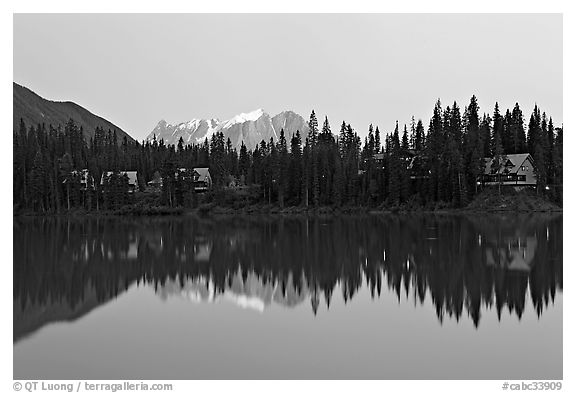 Trees and cabins reflected in Emerald Lake, dusk. Yoho National Park, Canadian Rockies, British Columbia, Canada (black and white)
