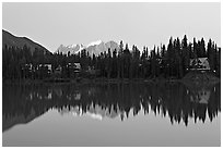 Trees and cabins reflected in Emerald Lake, dusk. Yoho National Park, Canadian Rockies, British Columbia, Canada ( black and white)