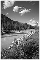 Suspension bridge crossing the Vermillion River. Kootenay National Park, Canadian Rockies, British Columbia, Canada ( black and white)