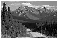 Kootenay Parkway highway and mountains, afternoon. Kootenay National Park, Canadian Rockies, British Columbia, Canada (black and white)