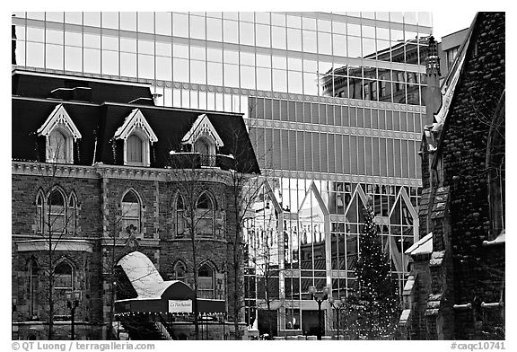 Reflection of an older building in the glass of a modern building, Montreal. Quebec, Canada (black and white)