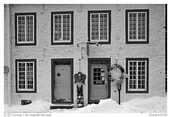 Facade in winter with snow on the curb,  Quebec City. Quebec, Canada (black and white)