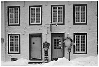 Facade in winter with snow on the curb,  Quebec City. Quebec, Canada ( black and white)