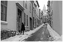 Narrow street partly covered with snow, Quebec City. Quebec, Canada (black and white)