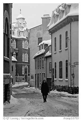 Man walking in a street in winter, Quebec City. Quebec, Canada (black and white)