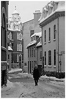 Man walking in a street in winter, Quebec City. Quebec, Canada ( black and white)