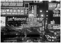 Nathan road, brilliantly lit by neon lights at night, Kowloon. Hong-Kong, China (black and white)