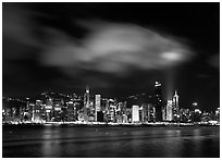 Hong-Kong Island skyline from the waterfront promenade by night. Hong-Kong, China (black and white)