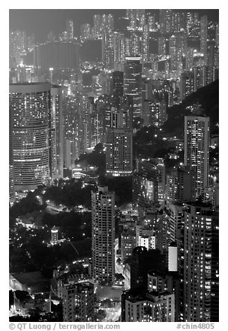 Residential towers on steep hillside from Victoria Peak by night. Hong-Kong, China (black and white)