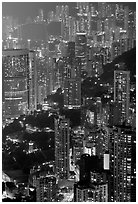 Residential towers on steep hillside from Victoria Peak by night. Hong-Kong, China ( black and white)