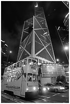 Old tram and Bank of China building (369m), designed by Pei, by night. Hong-Kong, China (black and white)