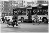 Tricyle, bicycles and bus on street. Beijing, China ( black and white)