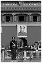 Guard in winter uniform and Mao Zedong picture, Tiananmen Square. Beijing, China (black and white)