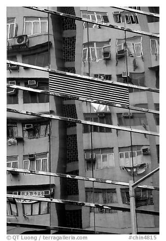 Reflection in glass building, Kowloon. Hong-Kong, China (black and white)