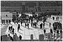 Crowd of tourists in the Sea of Flagstone (court of the imperial palace), Forbidden City. Beijing, China (black and white)