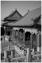 Pavilion with red columns and yellow roof tiles typical of imperial architecture, Forbidden City. Beijing, China ( black and white)
