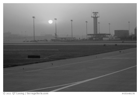 Tarmac and control tower at sunset, Beijing Capital International Airport. Beijing, China (black and white)