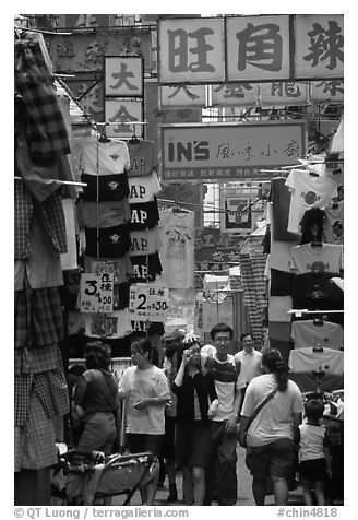 Crowded alley with clothing vendors, Kowloon. Hong-Kong, China (black and white)