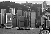 Skycrapers of Hong-Kong Island seen from the Promenade, early morning. Hong-Kong, China (black and white)