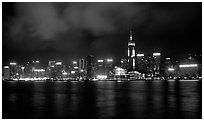 Colorful reflections of Hong-Kong Island lights across the harbor by night. Hong-Kong, China (black and white)